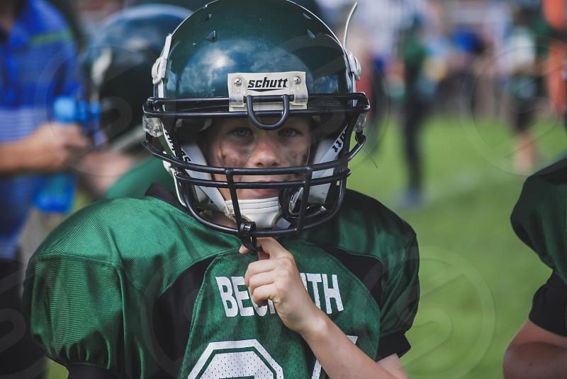 Football sports youth boy determination driven sweat focus colour face portrait nikon  photo