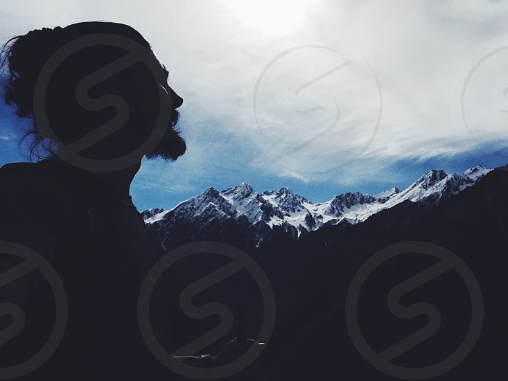 Himalayas mountains travel adventure profile silhouette remote peak snow high altitude man beard face view amazing asia india nepal photo