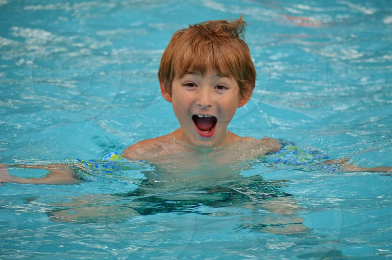 boy in swimming pool photo