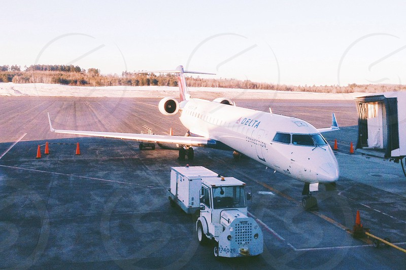 white airplane on the airport photo