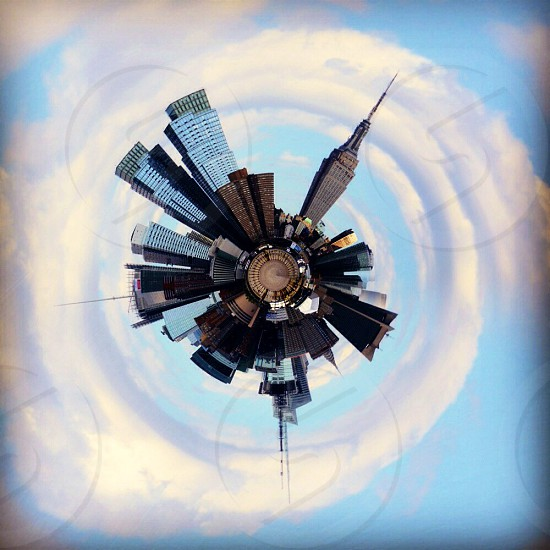 high rise building on planet painting photo