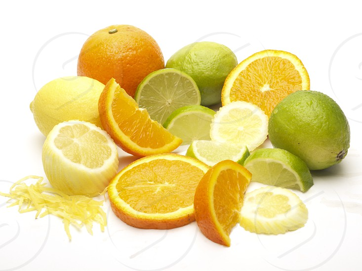 Selection of citrus fruits on a pure white background. photo