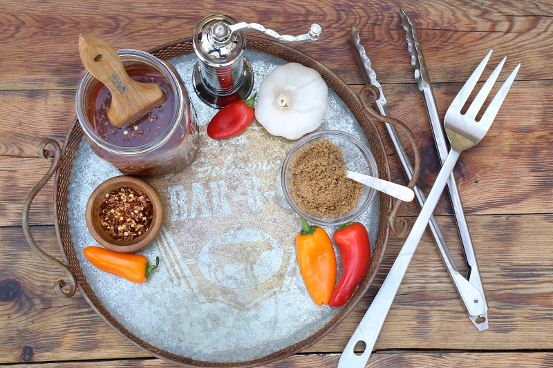 Barbecue Tray with Sauce Peppers Garlic and Brown Sugar photo