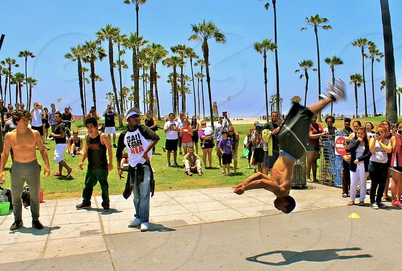 Venice beach Southern California home California street performers dancing flipping flips street photo