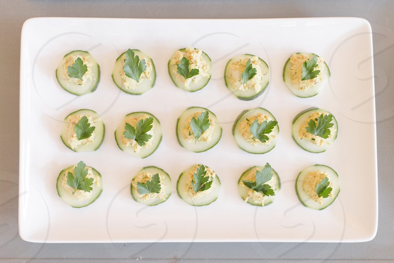 green dumplings with green leaf on tray photo
