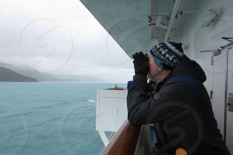 senior travel sightseeing  binoculars whale watching Alaska nature exploring  summer photo