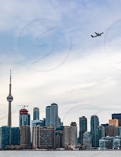 Aircraft starting from Toronto's city airport with downtown skyline including CN tower photo