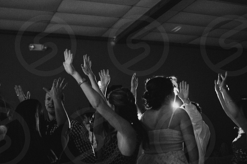 group of people dancing in a room in black and white photo