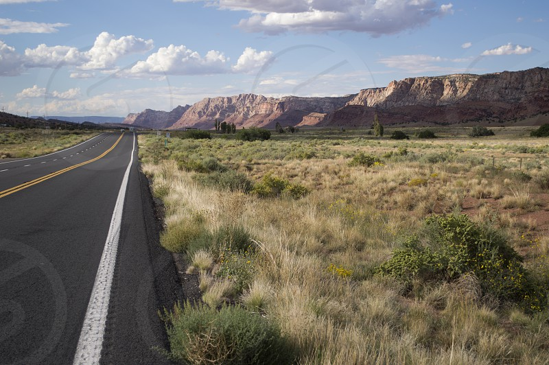 Long stretch of highway leading off into the scenic high desert mountains of Northern Arizona near the Grand Canyon. photo