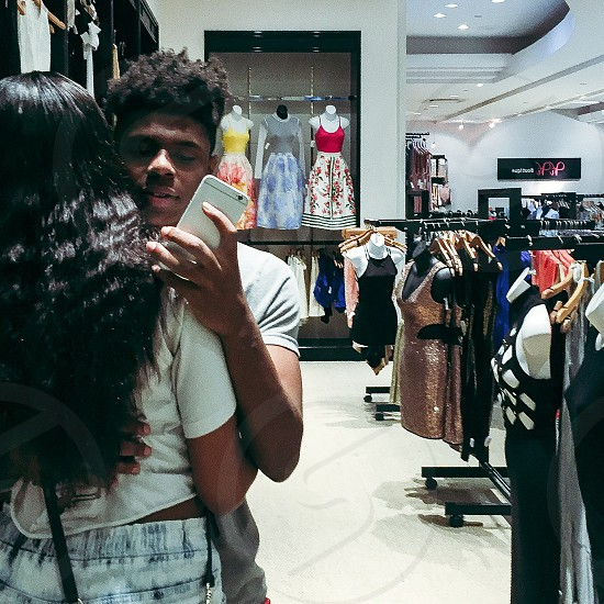 Couples; mall; clothes; mirror picture; dresses. photo
