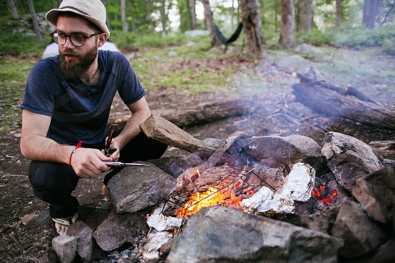 cooking camping camp fire fire nature backpacking dinner photo