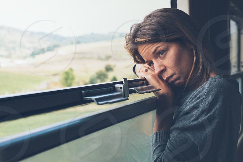 Depressed young woman in the train photo
