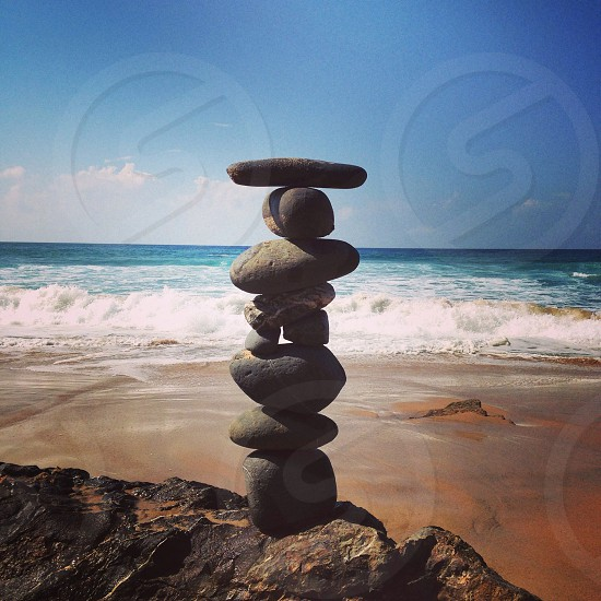 Beauty is in the eye of the beholder. Beach scene stacked stones photo
