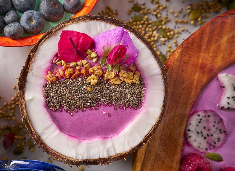 Acai bowl smoothie inside coconut chia granola blueberry and pitaya dragon fruit photo