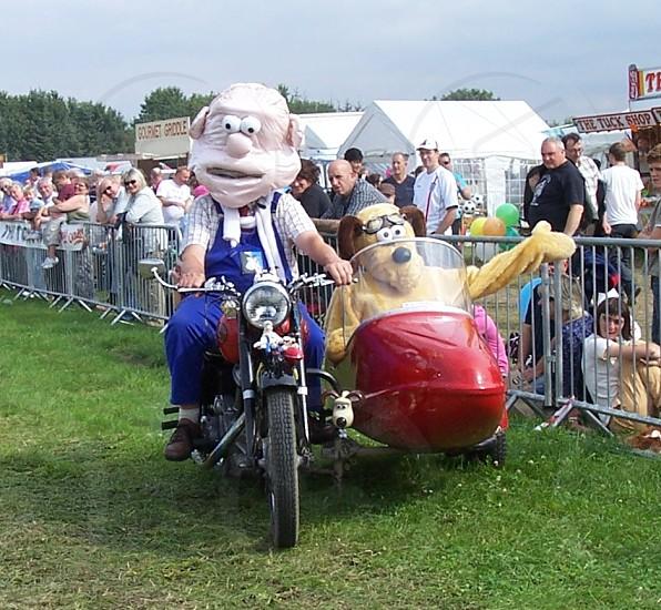 Wallace and Gromit enjoying biking. photo
