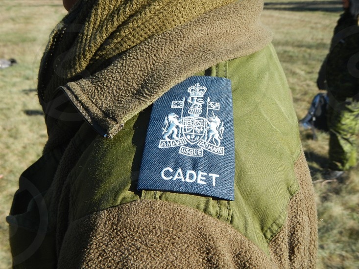 person wearing brown and green Cadet coat photo