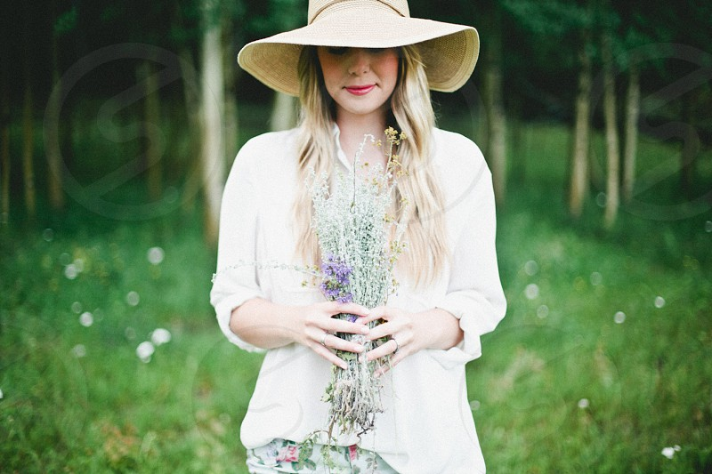 woman holding wild flowers photo