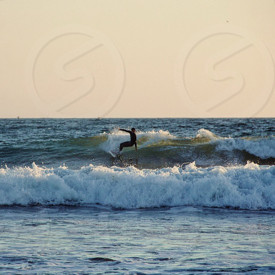 Surfer; Venice; beach; California; water; ocean; waves photo