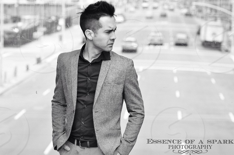 grayscale photography of man wearing notched lapel 2-buttons suit jacket photo