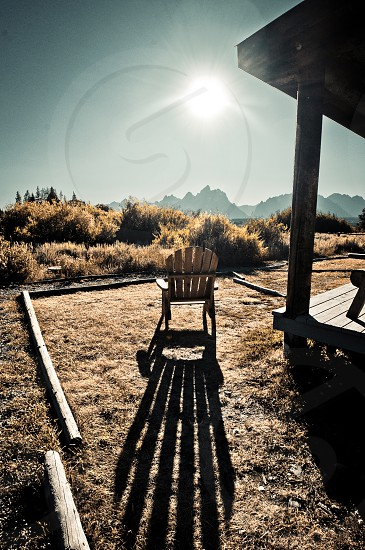 Empty chair in the mountains with long shadow photo