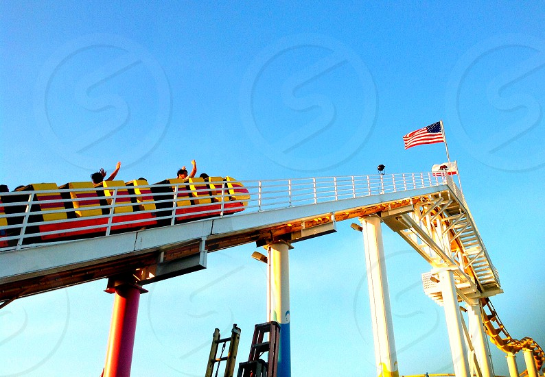 wave scream shout roller coaster America blue sky reaching heights adventure fun  photo