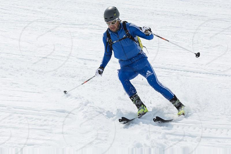 AVACHA KORYAK VOLCANOES KAMCHATKA RUSSIA - APRIL 27 2014: Ski mountaineer Alexander Sviridov skiing the Avacha Volcano. Team Race ski mountaineering Asian ISMF Russian Kamchatka Championship. photo