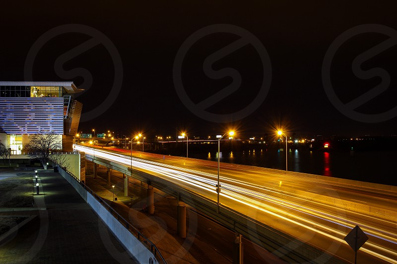 photo of brown concrete bridge with streetlights photo