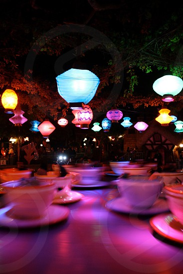 assorted-colored LED lights above white ceramic cups photo