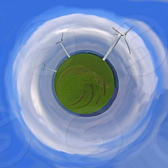 planet earth in the cosmos with wind wheels photo