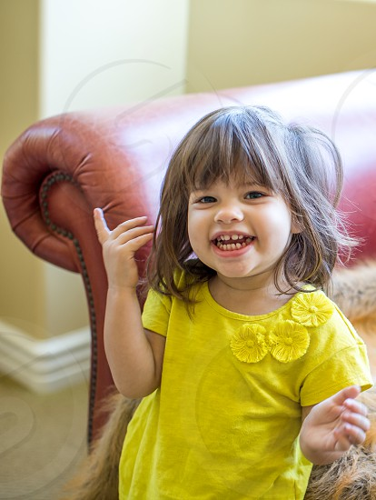 Happy Cute two year old girl photo