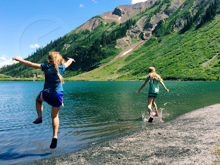 Lake nature mountains water scenic summer vacation camp camping kids children girls family fun play happy splash jumping in water jumping into lake sisters summer camp hike hiking outdoors health healthy brave  photo