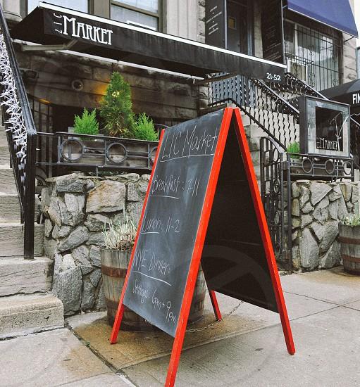 lic market nyc restaurant front with folding chalkboard photo
