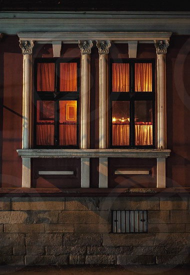 Details of windows of an old fashioned house night scene.  photo