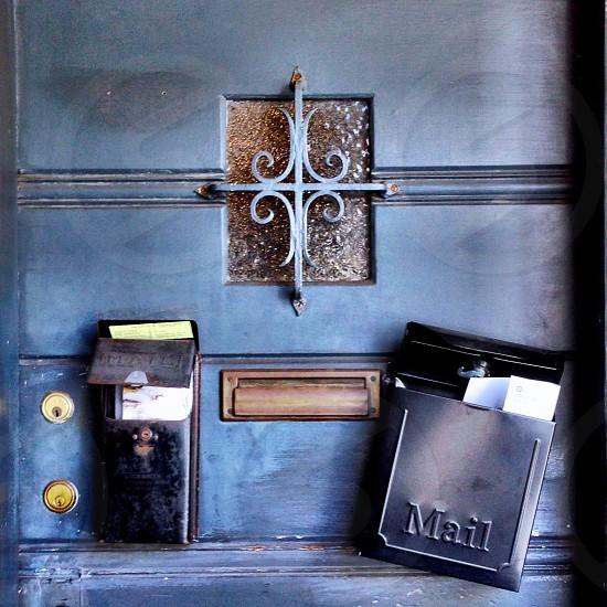 black mailbox on brown wooden door photo