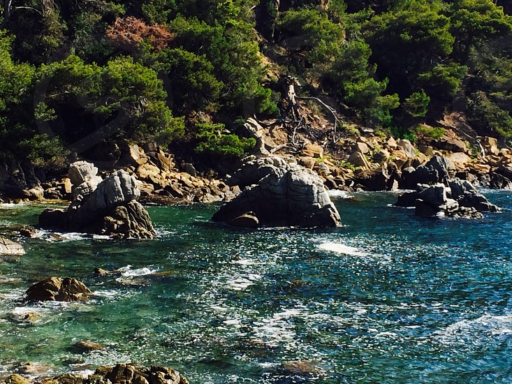 calm body of water with rock formations photo photo