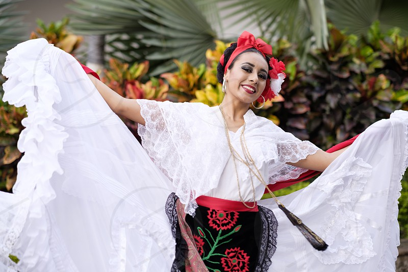 Woman dancing - Puerto Vallarta Jalisco Mexico. Xiutla Dancers - a folkloristic Mexican dance group in traditional costumes representing the culture and different regions of Mexico. photo