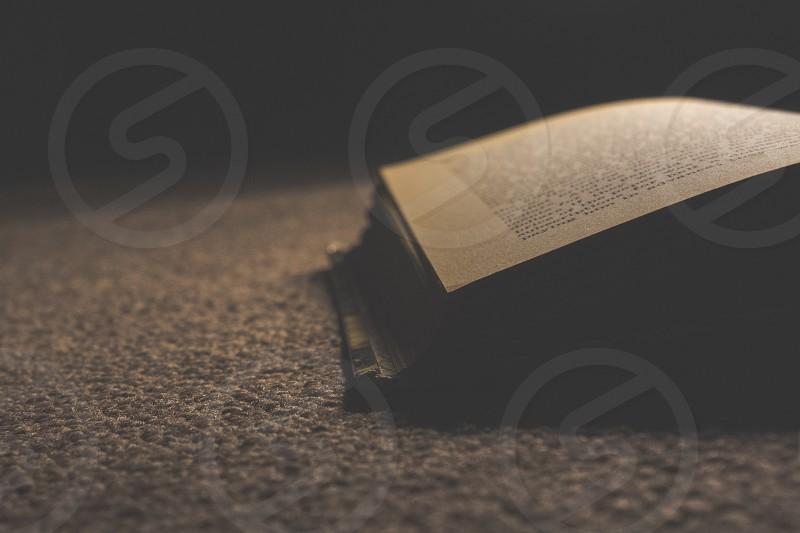open book on carpet photo