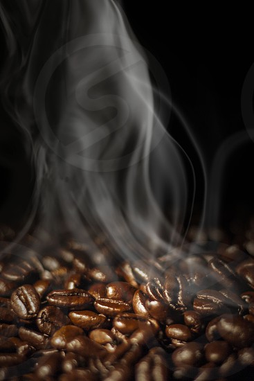 Coffee beans with smoke photo