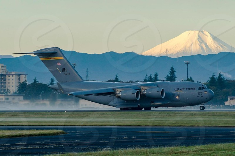 C-17 early morning departure from Yokota Air Base Japan. My. Fuji in the background.  photo