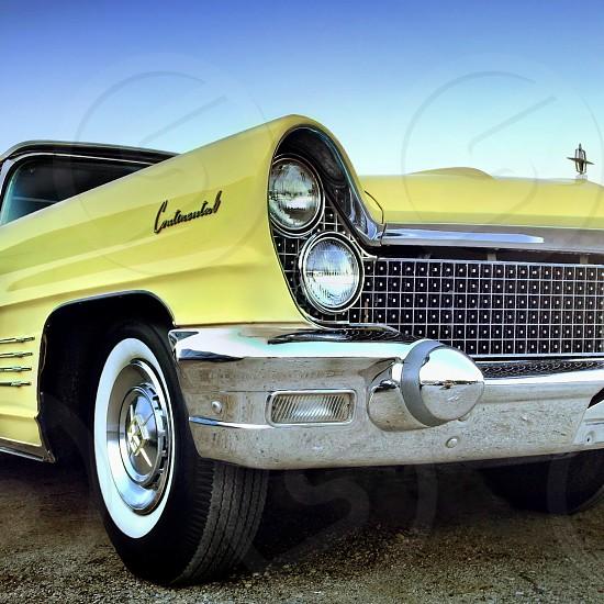 yellow vintage car photo