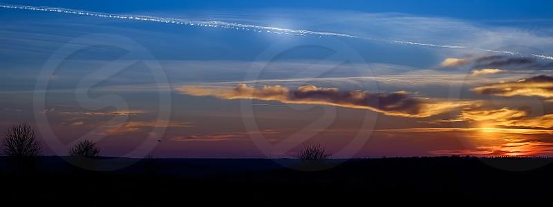 Sunset over field photo