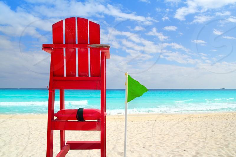 Baywatch red beach seat green wind flag in tropical caribbean sea photo