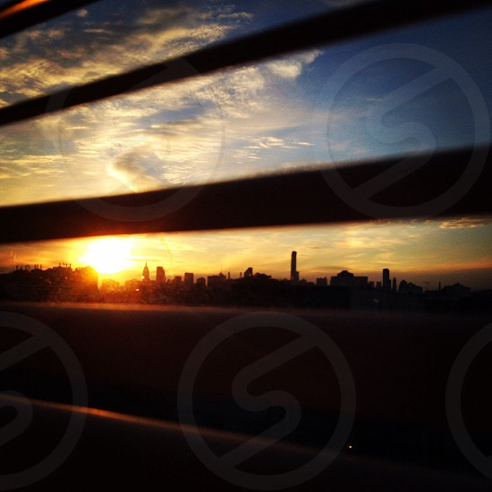 Manhattan skyline viewed through window blinds New York City photo