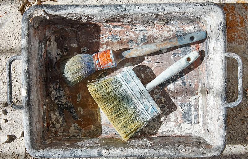 Paint brushes used on debris improvement background photo