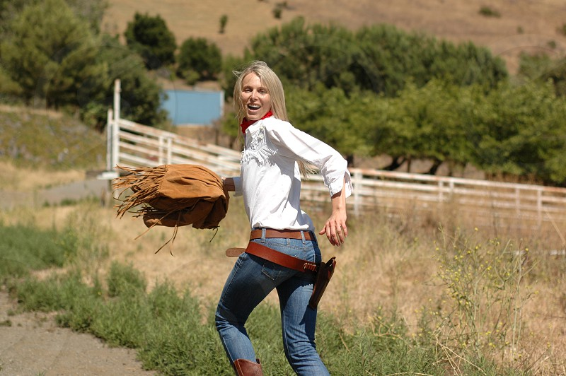 fashion woman run smile fan action motion hands holster forest trees stones morning sunrise firewood grass ground outdoor quiet landscape panorama mountains gun rancho rifle cowboy ranger ears photo