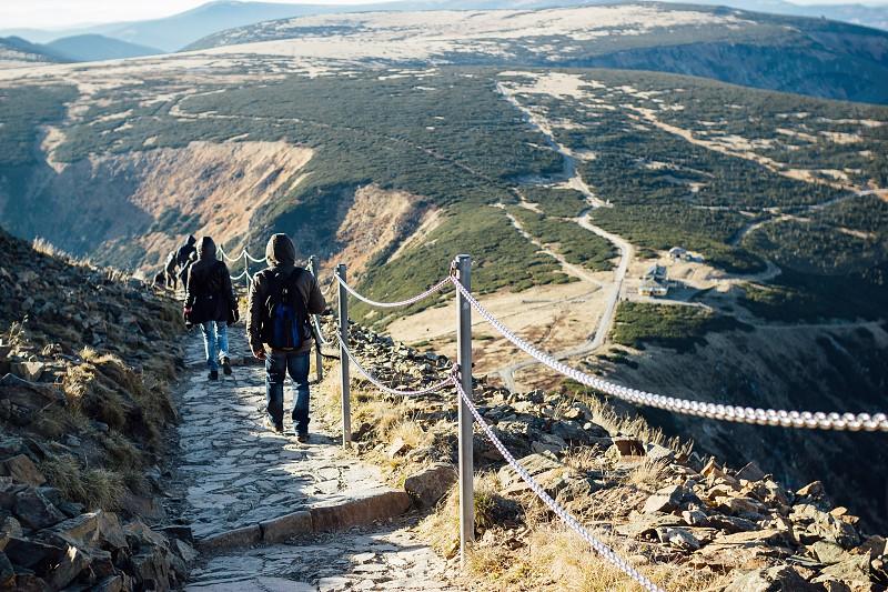 Couple walking down the mountain photo