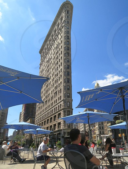 People taking a break in plaza near Flatiron Building New York City photo