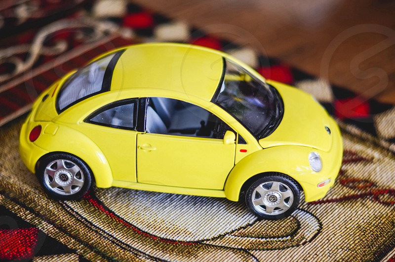 black and yellow toy volkswagen beetle photo