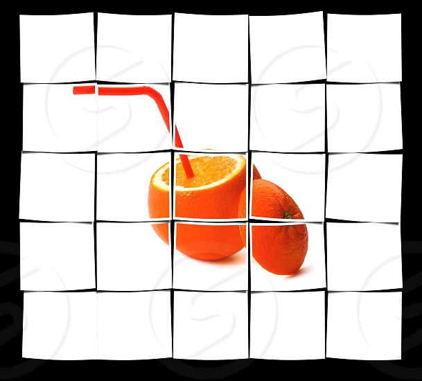 fresh ripe orange cutted on top with straw on white background photo