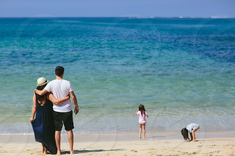 beach family kids parents girl girls travel holiday love mum dad ocean water sea twin sun summer  photo